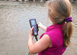 Girl measuring salinity with a YSI